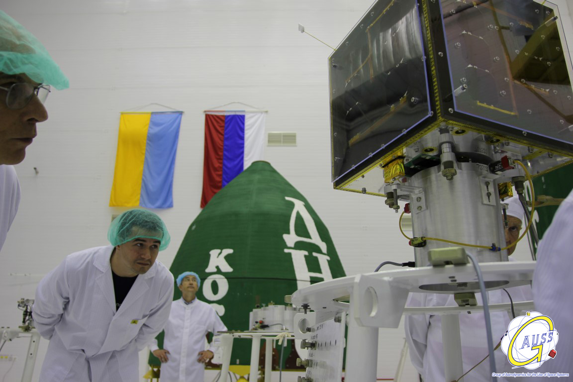 Gauss team member inspecting the satellite matching