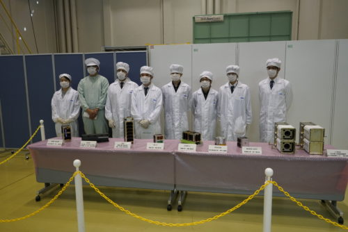 Equipe preparing the satellites to be mounted on the J-SSOD